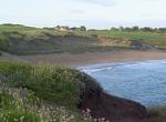 Von der Küste aus Sieht man beides: Strand und das Haus am Meer